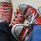 two pairs of red converse allstars by momarch
