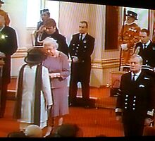 Queen Elizabeth  of England.. presenting the MBE by marieangel