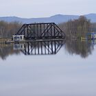 Bridge over still water by JBTHEMILKER