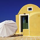 White Umbrella on Terrace of Yellow House, Santorini  by Petr Svarc
