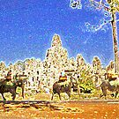 Elephants by the Bayon Temple by Mike Mahalo