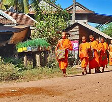 Buddhist monks with begging bowls by Adri  Padmos