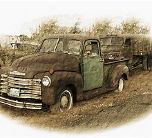 Two Old Trucks by CarolM