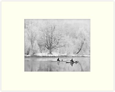 Canoes on river in winter by Manfred Belau