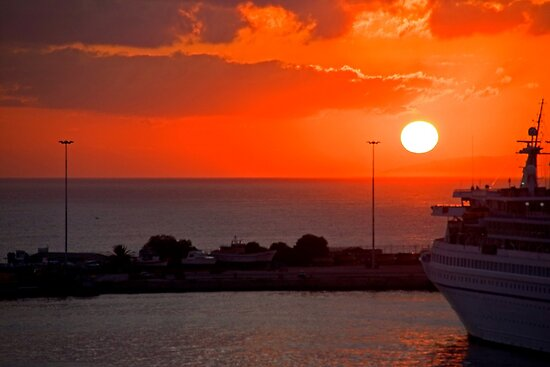 Sunrise over Heraklion Harbour by Tom Gomez
