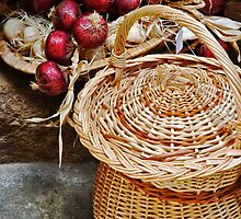 Basket with onions by Silvia Ganora