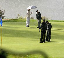 Golfers in the rain by paulineca