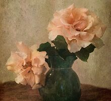 two apricot roses in a green jug by picketty