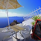 Santorini cliff-side cafe by joel Durbridge