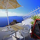 Santorini cliff-side cafe by joel Durbridge