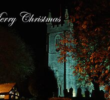 Merry Christmas - St. Andrews, Stratton, by night by imageworld