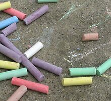 Discarded Color- colored chalks against a cement background by AmandaFerryman