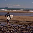 Surfer heading to waves by Whole Shot  Photography