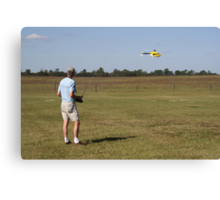 Flying a Radio Controlled Helicopter Canvas Print