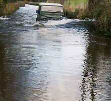 A Land Rover makes it through floods! by Simon Hathaway