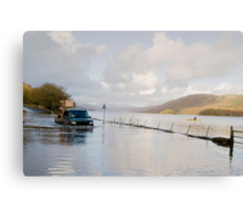 A Land Rover and canoe share the water at Coniston. Canvas Print