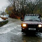 A Land Rover makes it through the floods in Ambleside. by Simon Hathaway