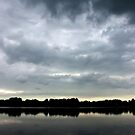 Dark clouds over the lake by steppeland
