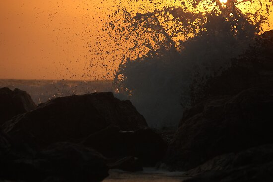 waves break as the sun rises by Matt  Williams