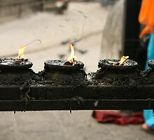 Candles at a Tibetan Monestry by Brooke Findlay