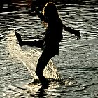 My daughter playing in water by Gavinmc