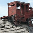 Stagecoach on Roof of Building in Holbrook, U.S.A. by Mywildscapepics