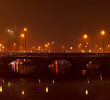 The Hula Hoop girl and Queens bridge in the fog. by Peter Ellison