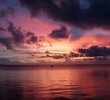 Sunset over Truk Lagoon by Mark Box