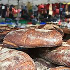 Market Series - Crustry bread with colourful backdrop by Christine Oakley