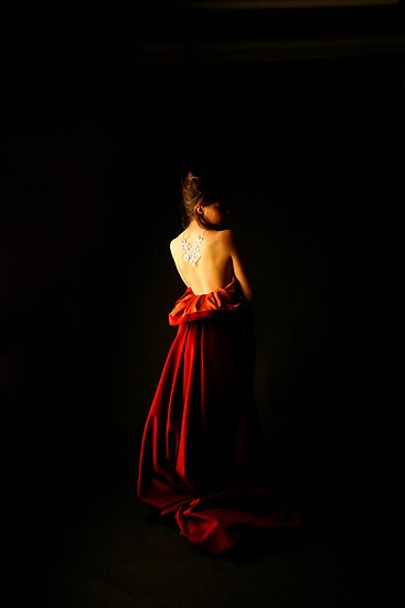 woman in red by Iris Anam Cara