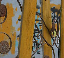 Old Rusted and Wood Fence by Lynn  Gibbons