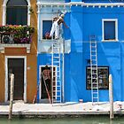 Painters at work on the island of Burano by Rowland Jones