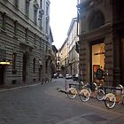 Narrow Street in  a Wide Citi-  Milan, Italy  by Mary Sedici