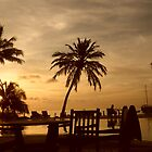 a sunset across the sea. The Maldives, Meeru Island by Charlie Pallett