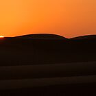 Sunset over the dunes by Paige