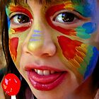 Cute little girl with face paint and lolly pop by Dave P