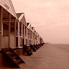 empty beach huts by Adam North