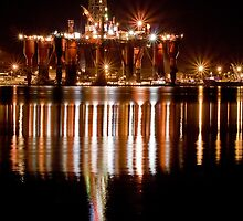 Rig at night by John Ellis