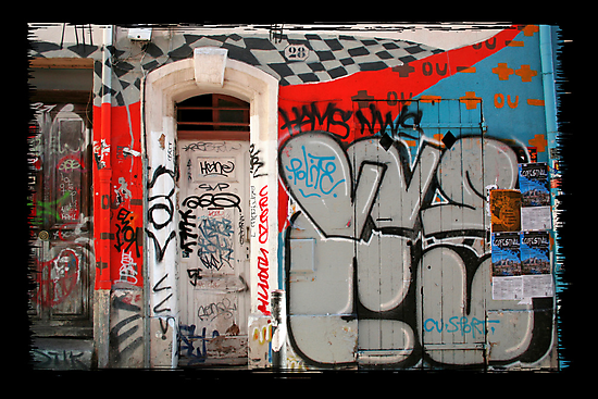 Wall, door and graffitis by Martine Affre Eisenlohr