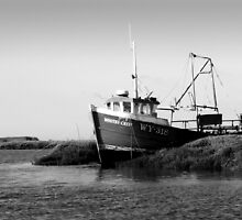 Fishing Boat at Anchor, Brancaster in Norfolk - monochrome by johnny2sheds
