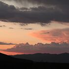 Sunset and clouds - Southern New Mexico by Kwon Ekstrom