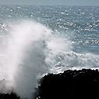 breakers over the rocks by tego53