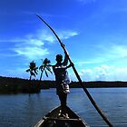 Silhouette of a man on the Kerala Backwaters by Leila Cutler