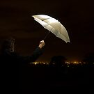 Abstract Umbrella At Night On A Rooftop by Peter Bower