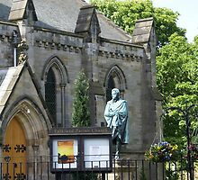 Falkland Parish Church and monument to former laird by BronReid