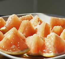 Plate of Juicy, Citrus Triangles by Bella  Cirovic