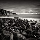 Beached basalt boulders. by GlennC