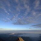 clouds rise at dawn - jade mountain by Ryan Bird