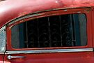 Window reflected in classic car Cuba by buttonpresser