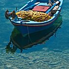 Lonely boat by Konstantinos Arvanitopoulos